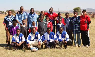 Mbelebeleni Community players with their LV SOSKITAID rugby kit