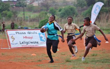 A Mphetseni Primary player going for the try line at the Day of the Girl Child tag rugby tournament