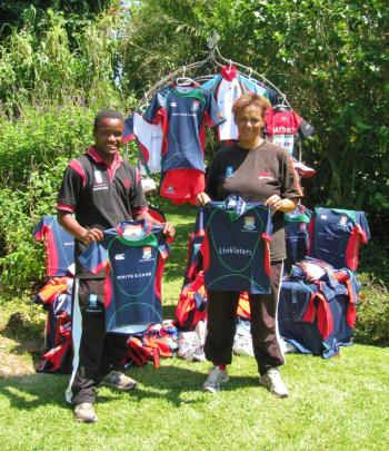 Wilson and Naomi with the Sandy Bay Rugby Club kit donation