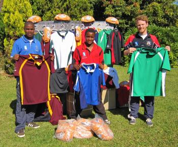 Malindi Dlamini, Wilson Dlamini and Toby Hanington with the kit donated by James Gilbert SA