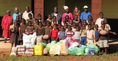 Mamba orphans with the food, drinks and clothing donations