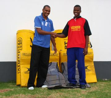 Mario De Sousa with Ngwenya Rugby Club captain Wandile Nhlabatsi with some of the Rugby equipment